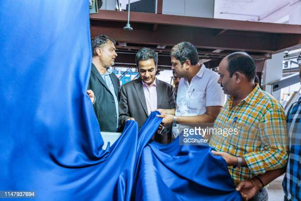 textile industry owner inspecting the quality - industrial equipment stock pictures, royalty-free photos & images