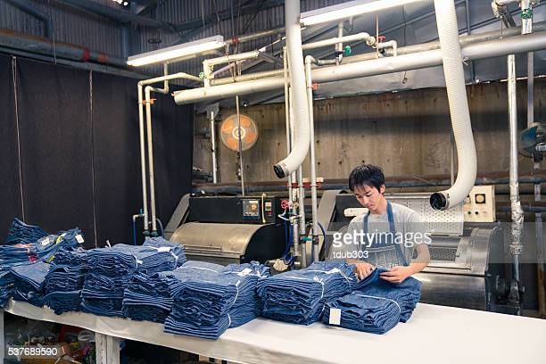 textile industry worker counting garments before shipping