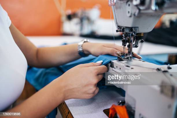 textile industry workers - sewing stock pictures, royalty-free photos & images