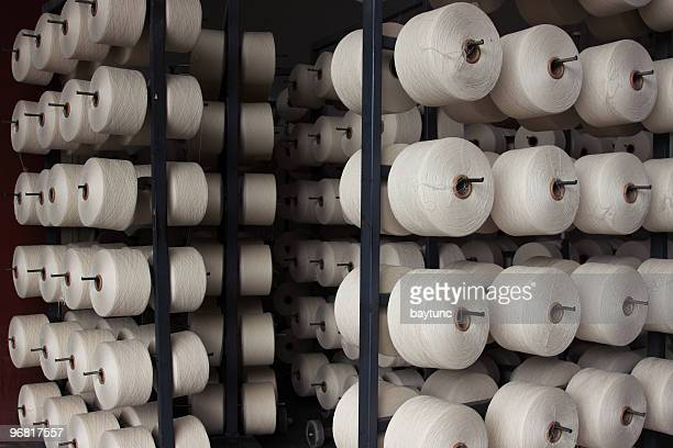 textile production - polyester stock photos and pictures