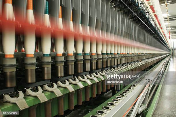 textile production - spinning - polyester stock photos and pictures
