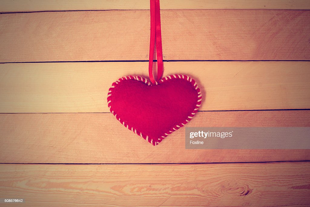 Textile red heart on a wooden texture : Bildbanksbilder