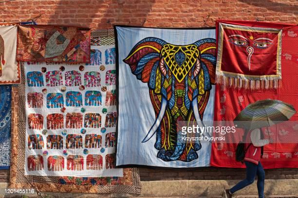 textiles for sale in the street, kathmandu - 仏陀の目 ストックフォトと画像