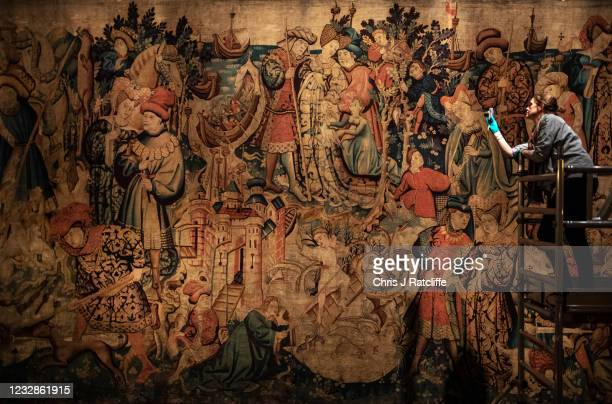 Textiles supervisor, Susie Stokoe, takes photos of the Devonshire Hunting Tapestries during a photocall at Chatsworth House on May 13, 2021 in...