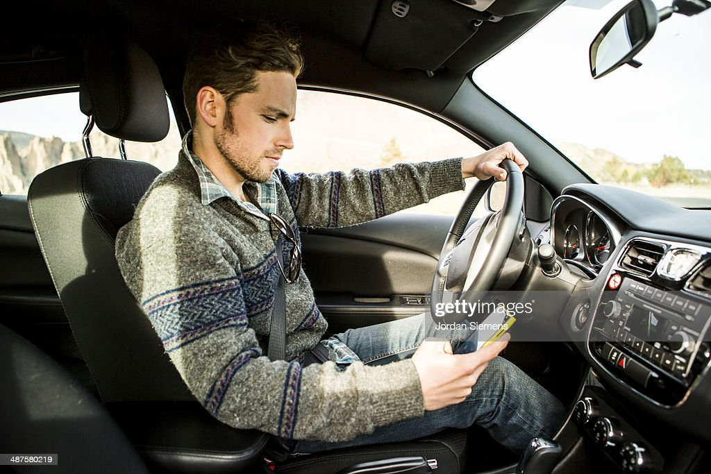 Texting and driving. : Stock Photo