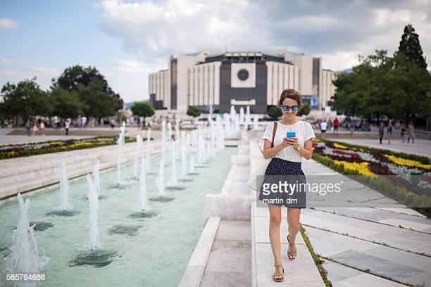 texting and walking-it's easy ! - sofia stock pictures, royalty-free photos & images