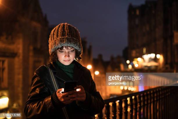 texting at dusk - scotland stock pictures, royalty-free photos & images