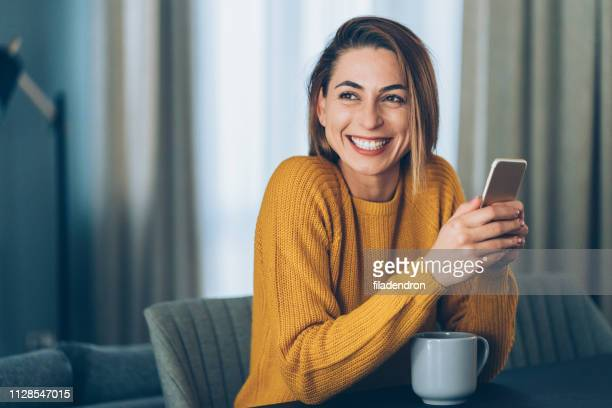 texting at home - cheerful stock pictures, royalty-free photos & images