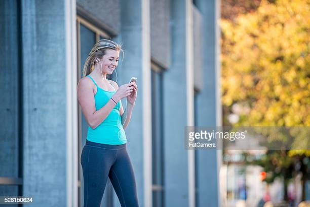 texting before a run - women wearing spandex stock photos and pictures
