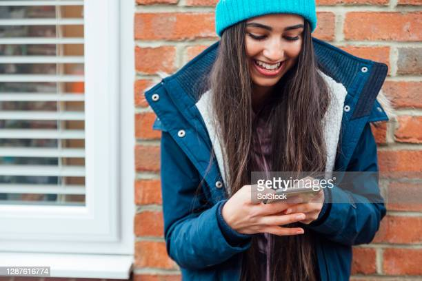 texting friends - adolescence stock pictures, royalty-free photos & images