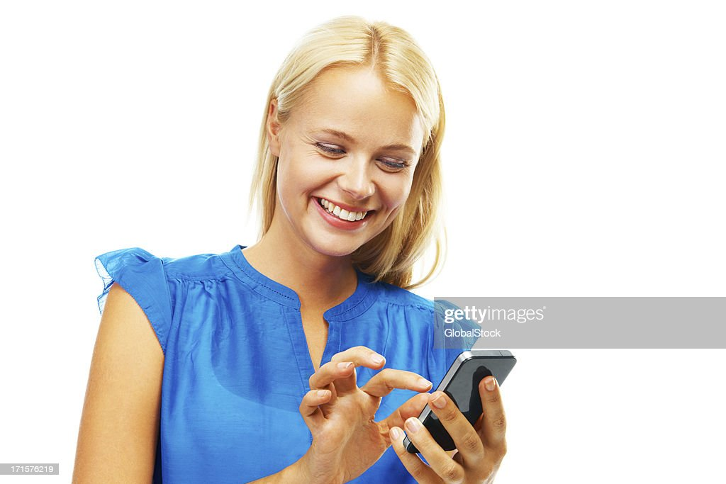 Texting her loved ones : Stock Photo