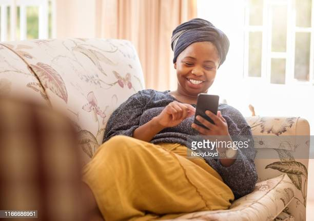 texting is her best pastime - africa stock pictures, royalty-free photos & images
