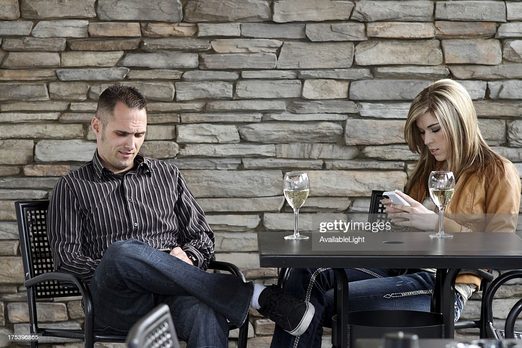 Texting on a Date : Stock Photo