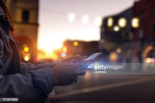 texting on mobile phone in venice - la, california - car pooling stock photos and pictures