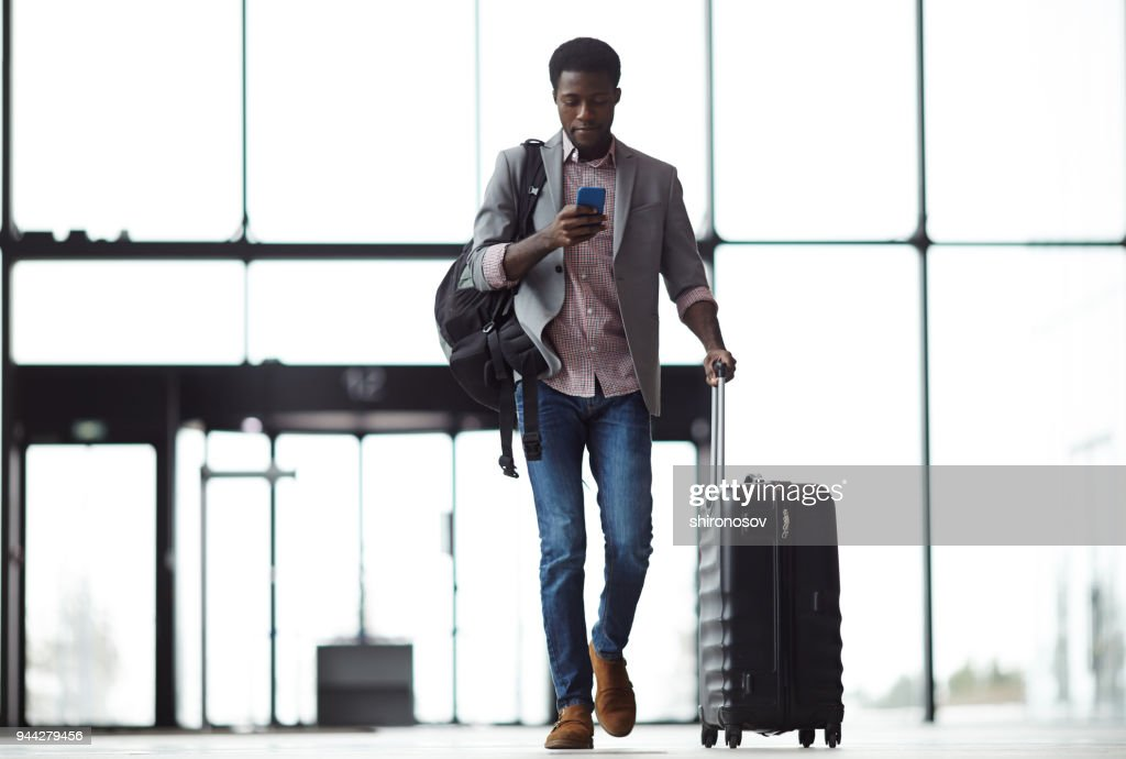 Texting on the move : Stock Photo