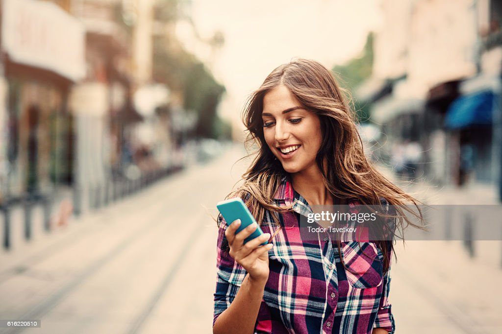 Texting on the phone : Stock Photo