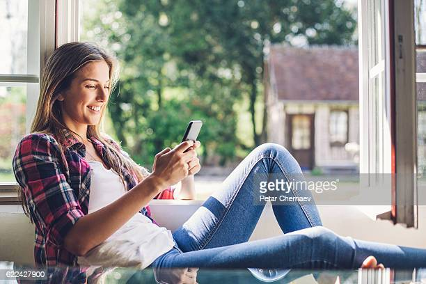 Texting on the windowsill