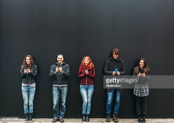 texting - five people stock pictures, royalty-free photos & images
