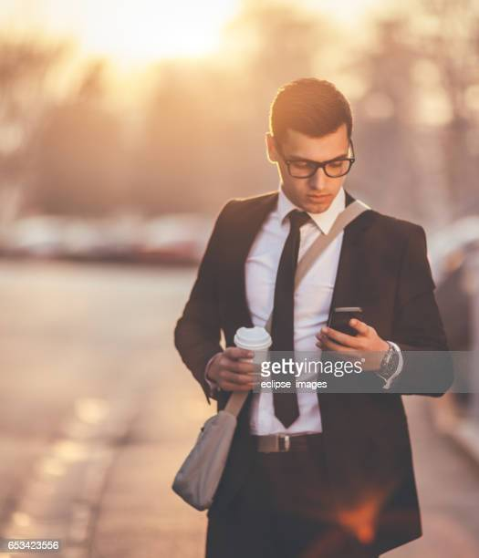 texting to boss - time management stock photos and pictures