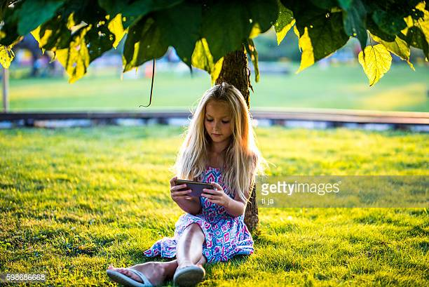 Texting under the tree