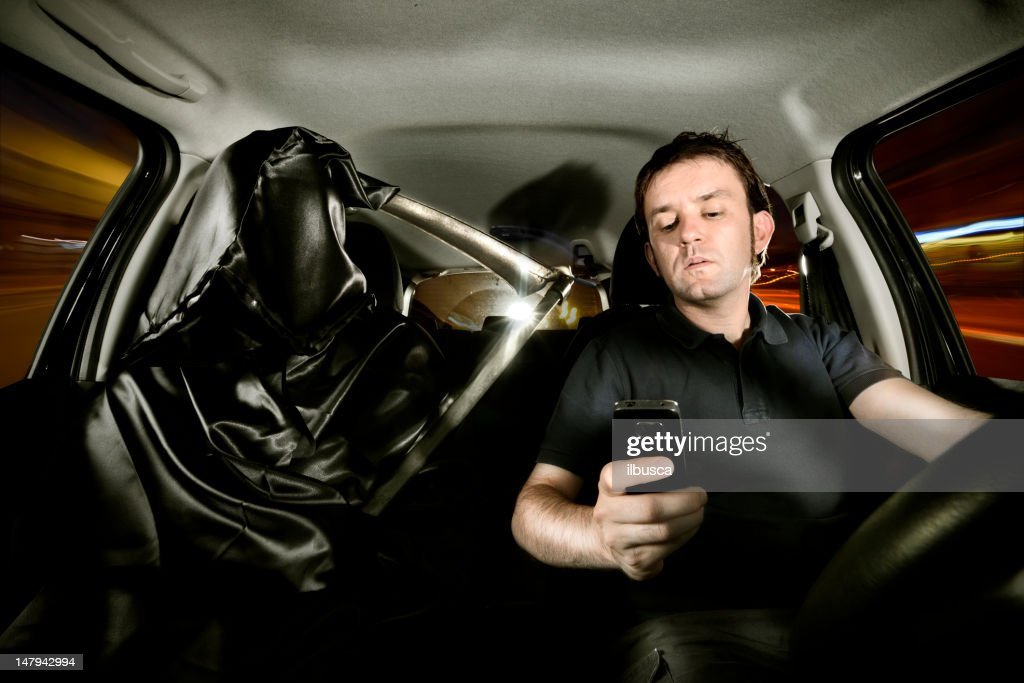 Texting while driving : Stock Photo