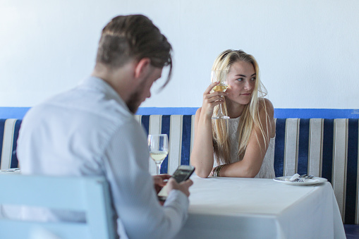 Texting while on a date. - gettyimageskorea