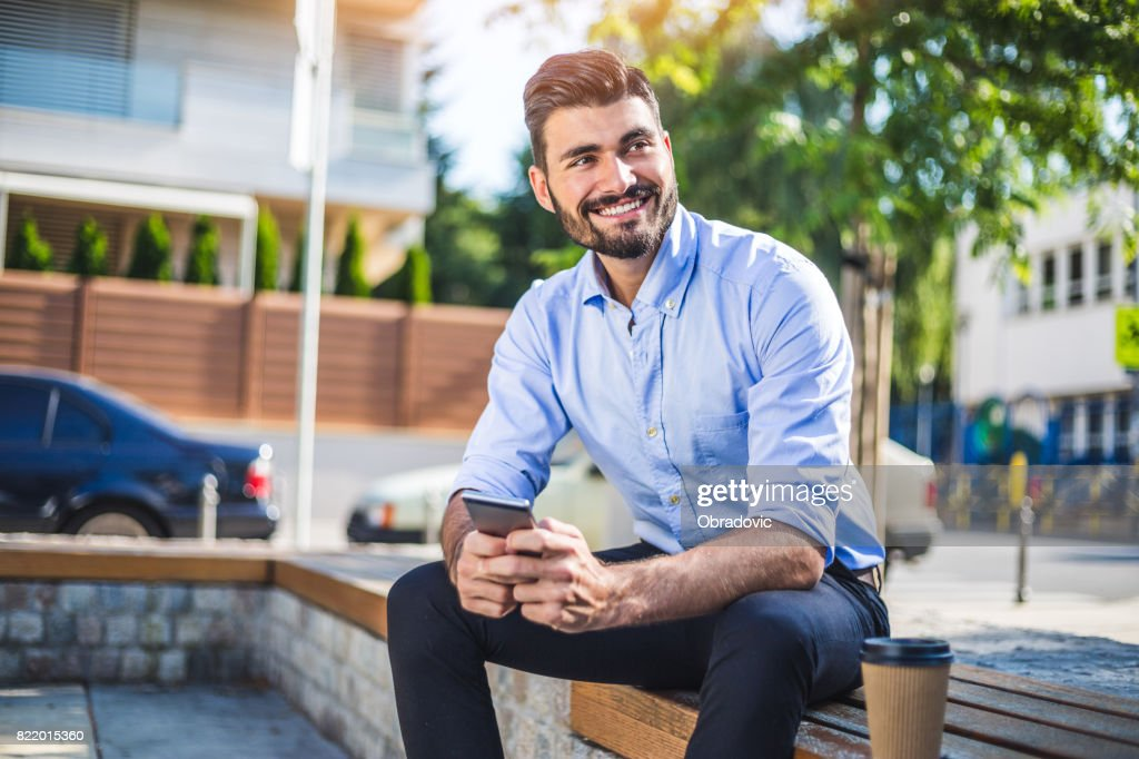 Texting with clients : Stock Photo