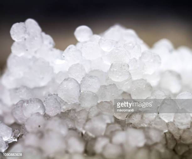 texture of icy hail on ground. ice crystal formation, pattern. hailstones - 雹 ストックフォトと画像