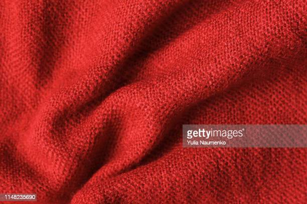 texture of knitted read fabric. light read thick winter fabric. - wool stock pictures, royalty-free photos & images