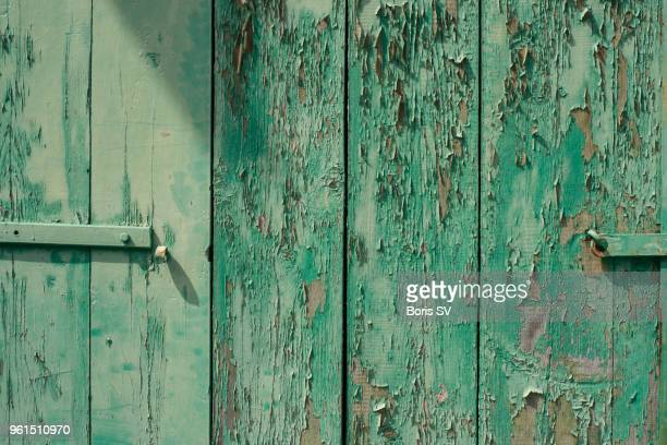 texture. old green paint on the wooden door - peeled stock pictures, royalty-free photos & images