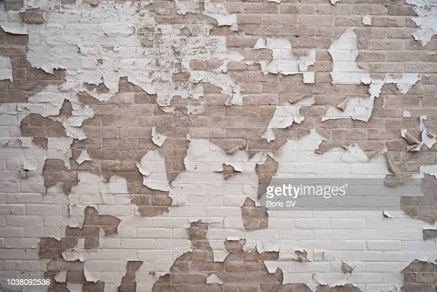 texture. old paint peeling from wall - run down stock pictures, royalty-free photos & images