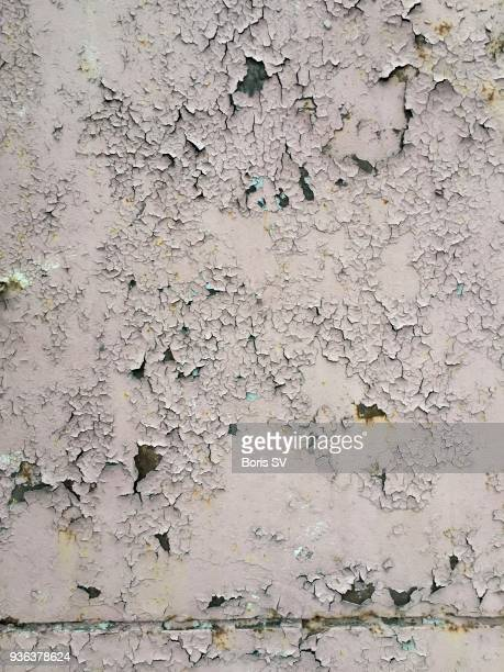 Texture. Old paint peeling from wall