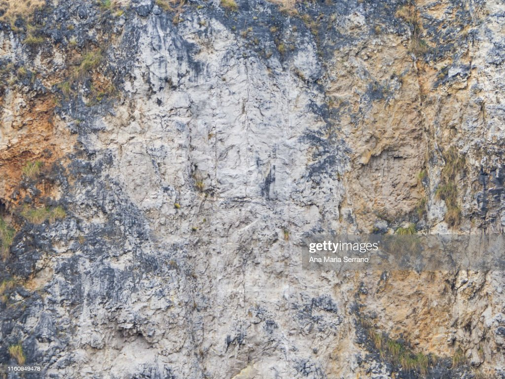 Texture or background of a stone wall in brown and gray colors : Foto de stock