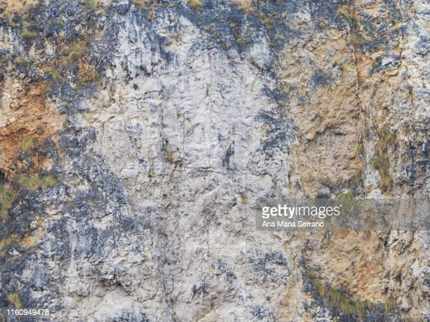 texture or background of a stone wall in brown and gray colors - stone wall imagens e fotografias de stock