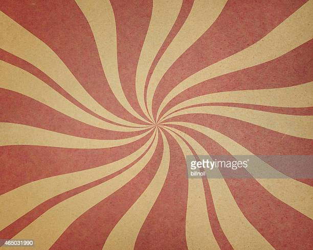 textured brown paper with red spiral pattern