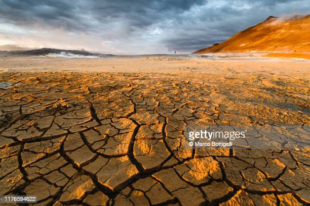 textured cracked mud landscape, iceland - climate change stock pictures, royalty-free photos & images