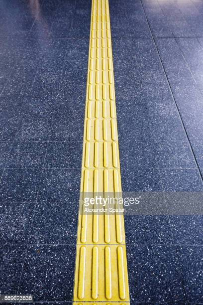 textured walkway for blind people - assistive technology stock photos and pictures
