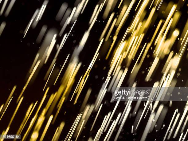 Textures of drops of water, of colors on a black bottom