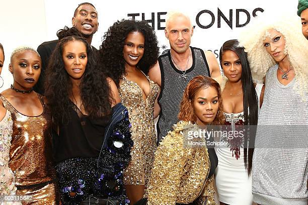 Teyana Taylor Cynthia Erivo Vicky Jeudy June Ambrose and Christina Milian pose for a photo with designers Phillipe Blond and David Blond backstage at...