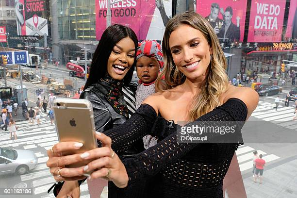 Teyana Taylor daughter Iman 'Junie' Shumpert and Renee Bargh pose for a selfie during their visit to 'Extra' at their New York studios at HM in Times...
