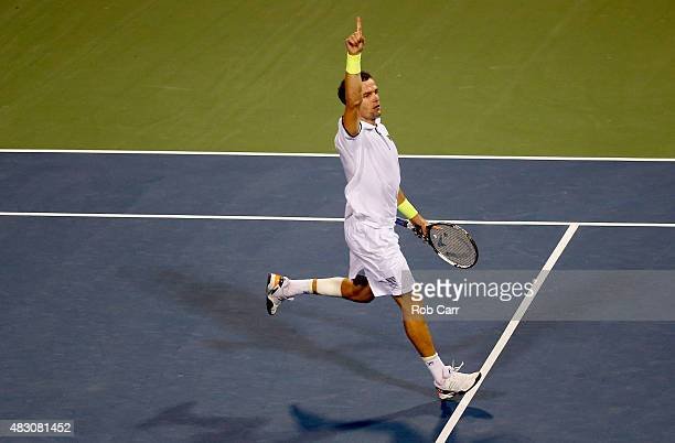Teymuraz Gabashvili of Russia celebrates after defeating Andy Murray of Great Britain in three sets during their singles match at Rock Creek Tennis...