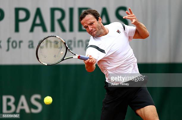 Teymuraz Gabashvili of Russia hits a forehand during the Mens Single first round match against Donald Young of the United States on day one of the...