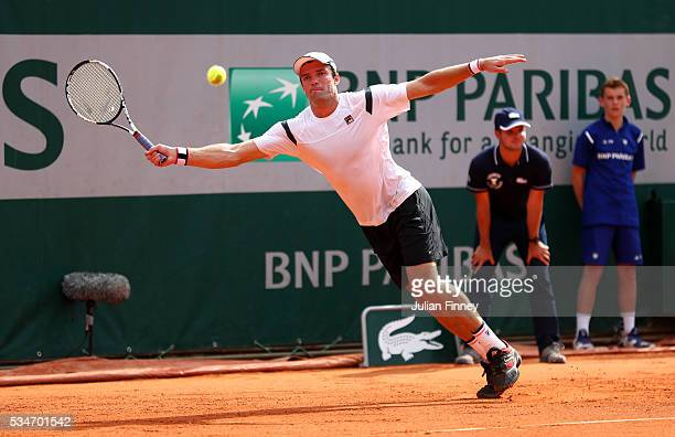 Teymuraz Gabashvili of Russia hits a forehand during the Men's Singles third round match against John Isner of the United States on day six of the...