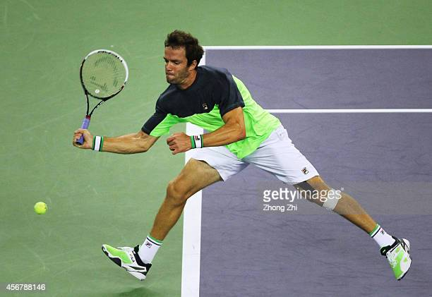 Teymuraz Gabashvili of Russia returns a shot during his match against Andy Murray of Great Britain during the day 3 of the Shanghai Rolex Masters at...