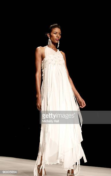 Teyona Anderson models designer David Tlale collection at the Arise Cape Town Fashion Week at the Cape Town International Convention Centre on August...