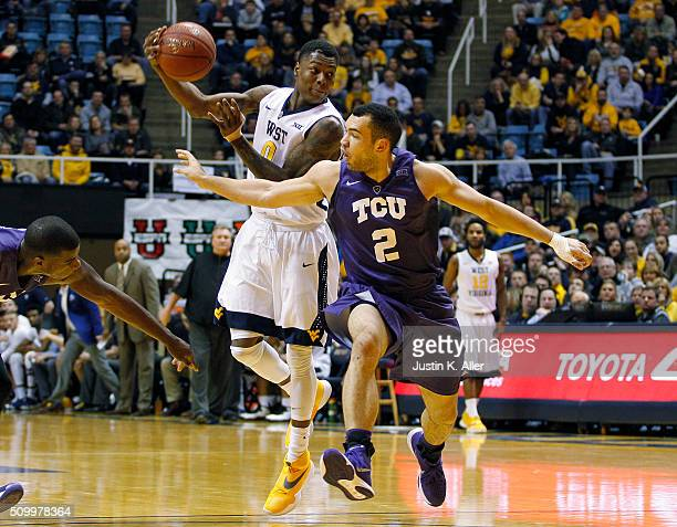 Teyvon Myers of the West Virginia Mountaineers makes a pass against Michael Williams of the TCU Horned Frogs during the game at the WVU Coliseum on...