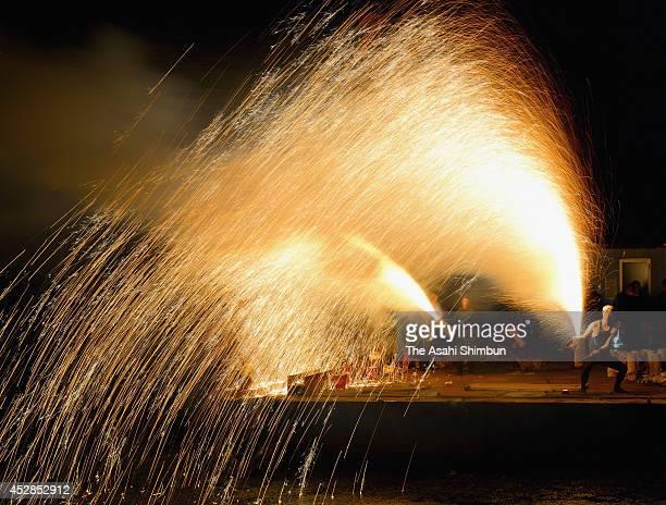 Tezutsu hanabi handheld fireworks shooting up into the night sky during the Mitarashi Festival at Tozaki Shrine on July 28 2014 in Otsu Shiga Japan...