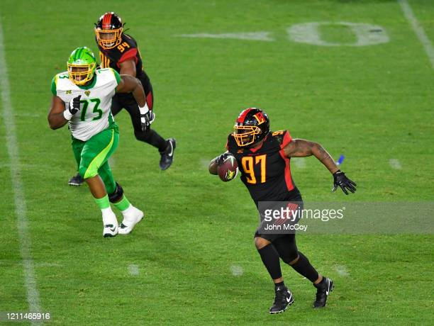 t/g Martez Ivey of the Tampa Bay Vipers goes after Reggie Howard of the LA Wildcats after he intercepted a pass at Dignity Health Sports Park during...