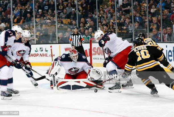 Tghe rebound comes off Columbus Blue Jackets goalie Sergei Bobrovsky for Boston Bruins left wing Anders Bjork during a game between the Boston Bruins...