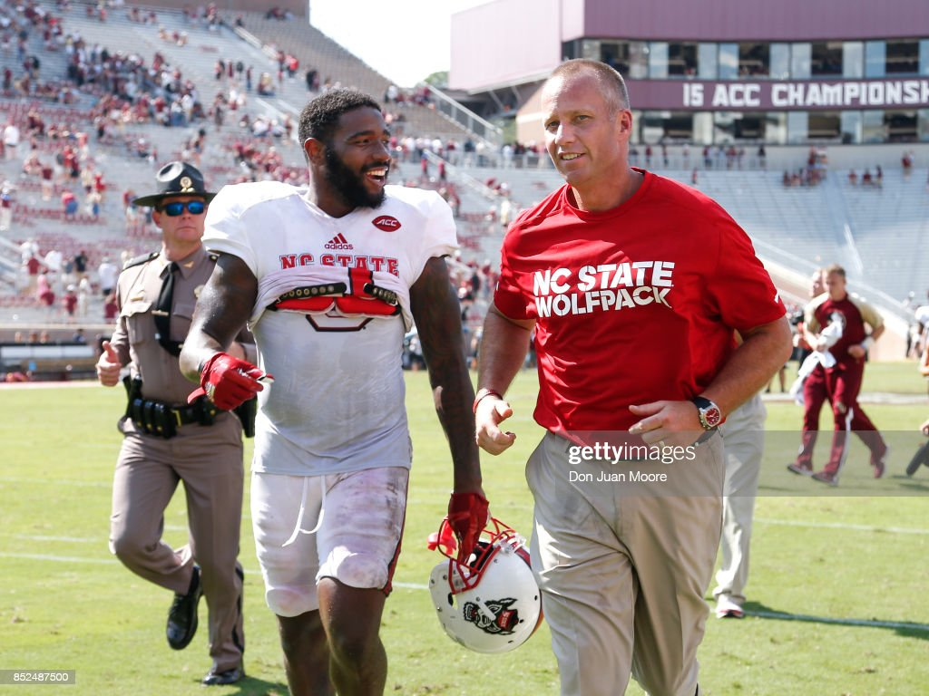 Tght End Jaylen Samuels #1 and Head Coach Dave Doeren of the North Carolina Wolfpack shares a laugh after game against the Florida State Seminoles at Doak Campbell Stadium on Bobby Bowden Field on September 23, 2017 in Tallahassee, Florida. NC State defeated #12 ranked Florida State 27 to 21.